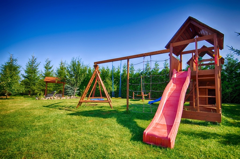 © Sebcz | Dreamstime.com - Childs Slide And Swings Photo